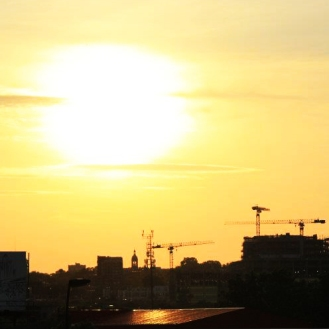 Montreal Sunsets- Cranes and Beer Advertisements
